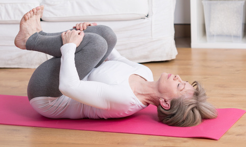 Mature woman practicing pilates